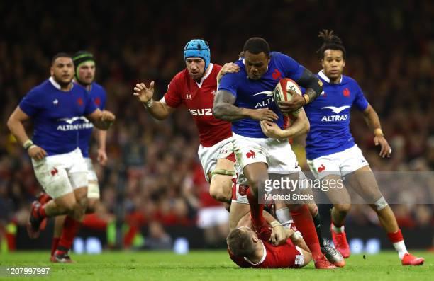 Virimi Vakatawa of France breaks through Dan Biggar of Wales during the 2020 Guinness Six Nations match between Wales and France at Principality...