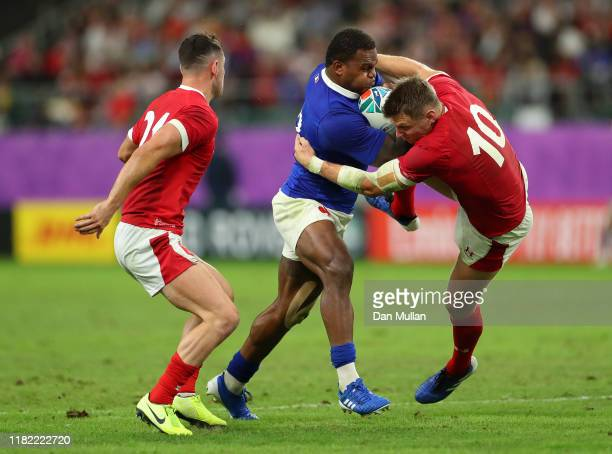 Virimi Vakatawa of France bumps off the tackle of Dan Biggar of Wales during the Rugby World Cup 2019 Quarter Final match between Wales and France at...