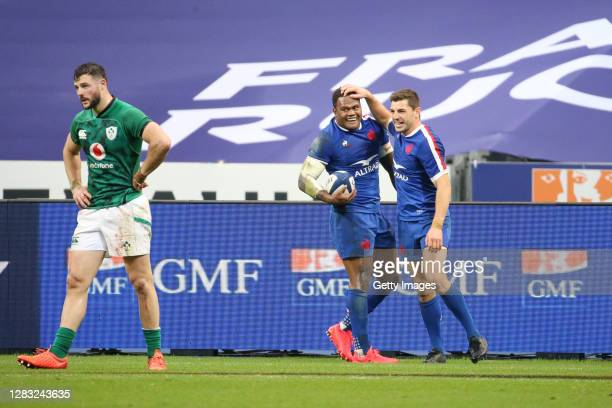 Virimi Vakatawa of France celebrates after scoring a try with Anthony Bouthier of France during the 2020 Guinness Six Nations match between France...