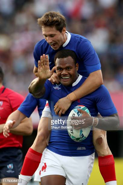 Virimi Vakatawa of France celebrates with Baptiste Serin of France after scoring his team's first try during the Rugby World Cup 2019 Group C game...
