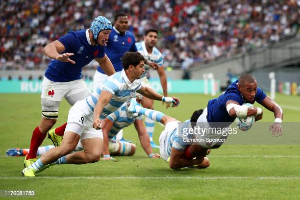 Virimi Vakatawa of France dives to score his side's first try during the Rugby World Cup 2019 Group C game between France and Argentina at Tokyo...