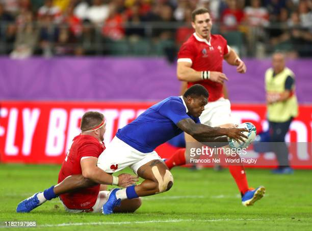 Virimi Vakatawa of France goes over to score his sides third try during the Rugby World Cup 2019 Quarter Final match between Wales and France at Oita...