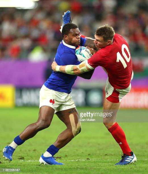 Virimi Vakatawa of France is tackled by Dan Biggar of Wales during the Rugby World Cup 2019 Quarter Final match between Wales and France at Oita...