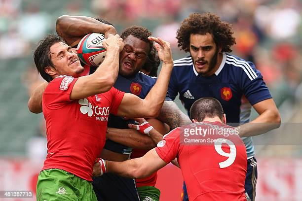 Virimi Vakatawa of France is tackled during the Bowl quarterfinal match between France and Portugal during the 2014 Hong Kong Sevens at Hong Kong...