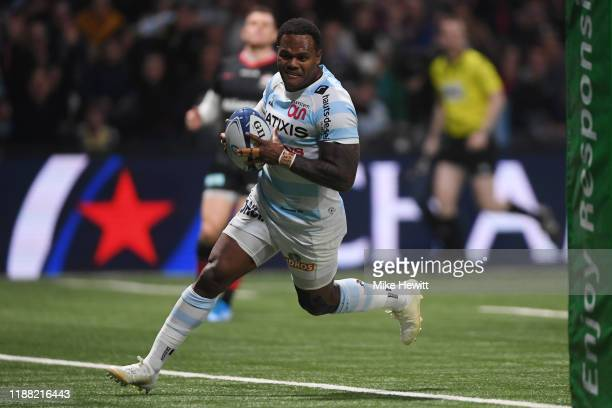 Virimi Vakatawa of Racing 92 crosses for the first try of the match during the Heineken Champions Cup Round 1 match between Racing 92 and Saracens at...