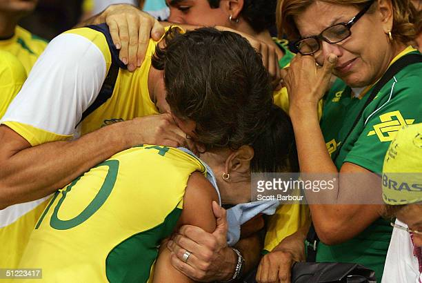Virna Das of Brazil is comforted by members of the crowd as she cries after Brazil lost the Brazil v Russia women's indoor Volleyball semifinal match...
