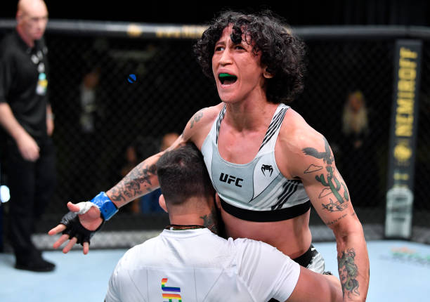 Virna Jandiroba of Brazil celebrates after her TKO victory over Kanako Murata of Japan in a strawweight bout during the UFC Fight Night event at UFC...