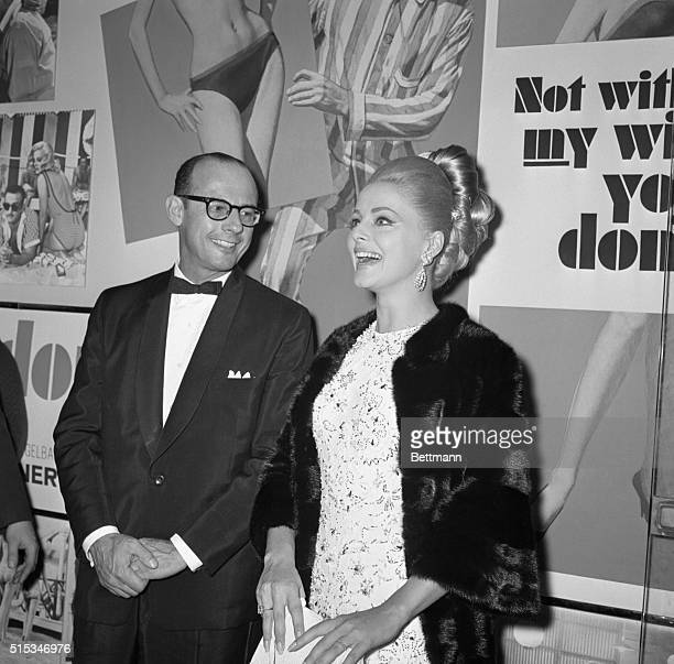 Virna Lisi Italian actress and husband Italian industrialist Franco Pesci at a movie premiere