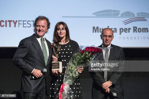 Virna Lisi's son Corrado Pesci Italian actress Monica Bellucci and Giuseppe Tornatore pose for a photo during the Virna Lisi Award at Auditorium...