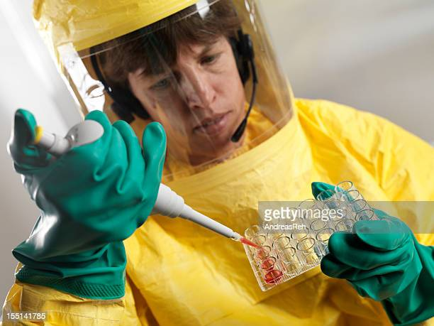 Virologist working with blood serum in high security laboratory