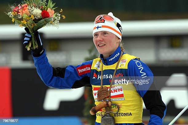 Virpi Kuitunen of Finland celebrates in the finish area after winning the nordic classicstyle 10 kms World Cup race on February 9 2008 in Otepaeae...