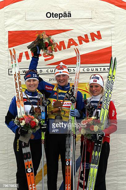 Virpi Kuitunen of Finland celebrates on the podium after winning the nordic classicstyle 10 kms World Cup race on February 9 2008 in Otepaeae Estonia...