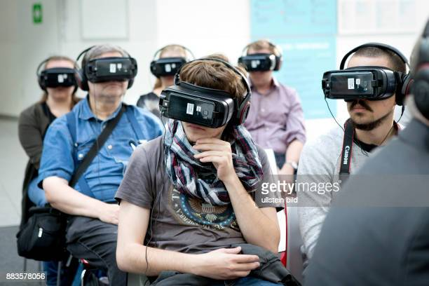 Virtual and augmented reality at the Photokina in Cologne People wearing virtual reality headmounted displays