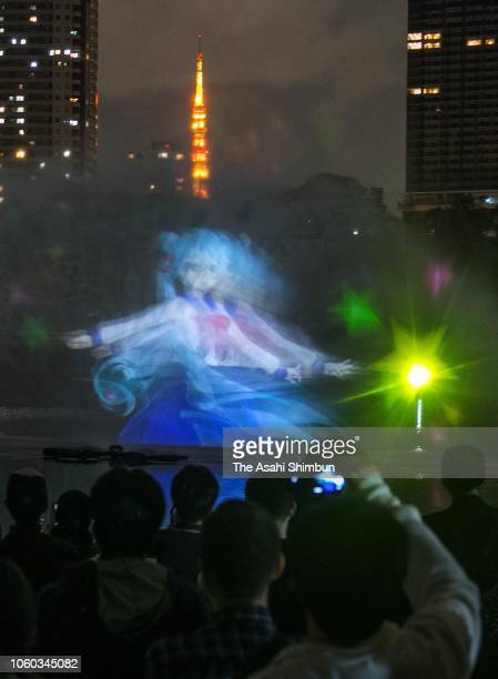 Virtual idol Miku Hatsune is displayed on a water screen at Hamarikyu Gardens on October 26 2018 in Tokyo Japan