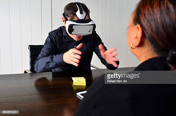 3d vr virtual reality business meeting - rafael ben ari stock pictures, royalty-free photos & images