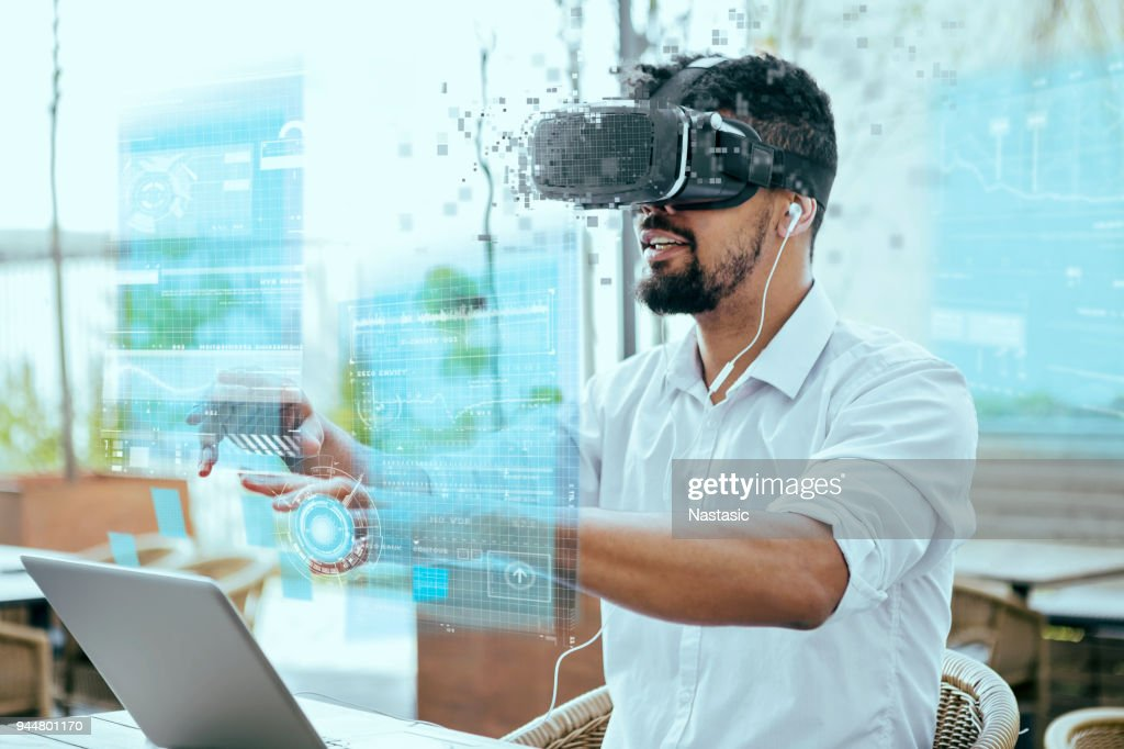 Virtual reality entertainment in outdoor cafe : Stock Photo