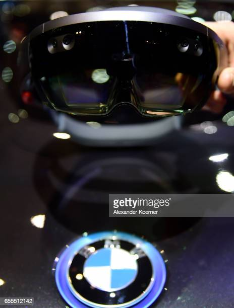 Virtual Reality goggle is held over an electrical BMW i8 car at the Intel stand at the CeBIT 2017 Technology Trade Fair on March 20 2017 in Hanover...