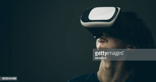 virtual reality - virtual reality simulator stock photos and pictures