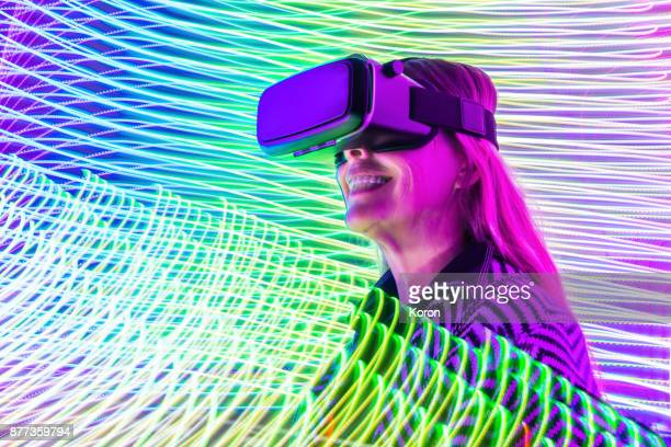 virtual reality - senior women with smile - image stock pictures, royalty-free photos & images