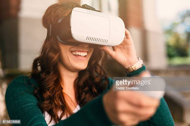 virtual reality simulator - head mounted display stock photos and pictures