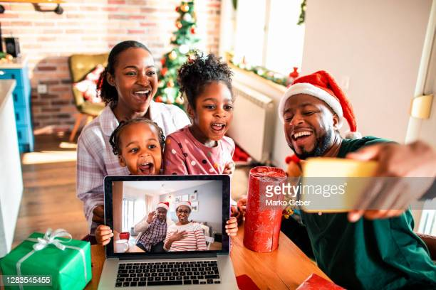 virtual selfie with their grandparents for christmas - holiday stock pictures, royalty-free photos & images
