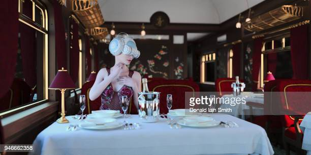 virtual worlds: woman with vr headset in dining car of a vintage train - orient express foto e immagini stock