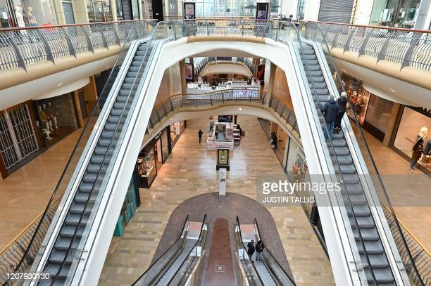 Virtually empty Bullring Shopping Centre in Birmingham in central England is pictured on the morning of March 21 a day after the British government...