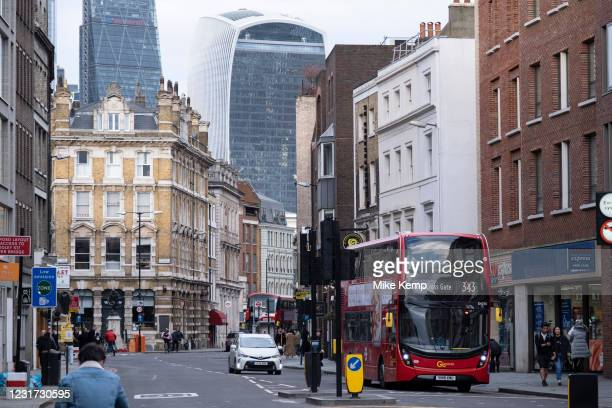 Virtually no traffic and very few people out and about on Borough High Street looking towards the City of London as the national coronavirus lockdown...