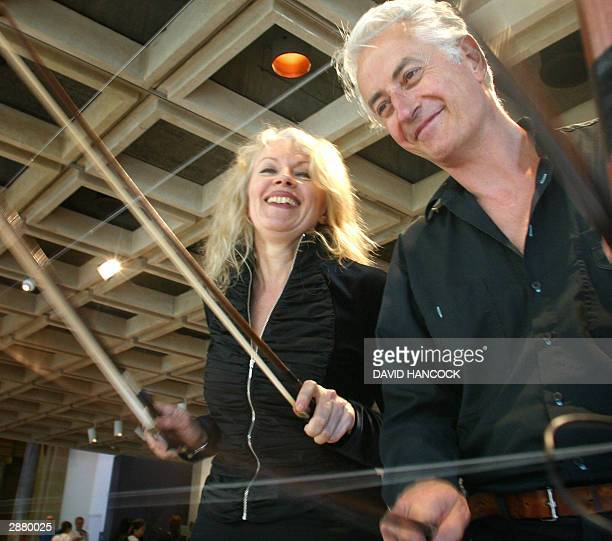 Virtuoso violinists Hollis Taylor and John Rose play a fence installation at the Art Gallery of New South Wales in Sydney 19 January 2004 The pair...