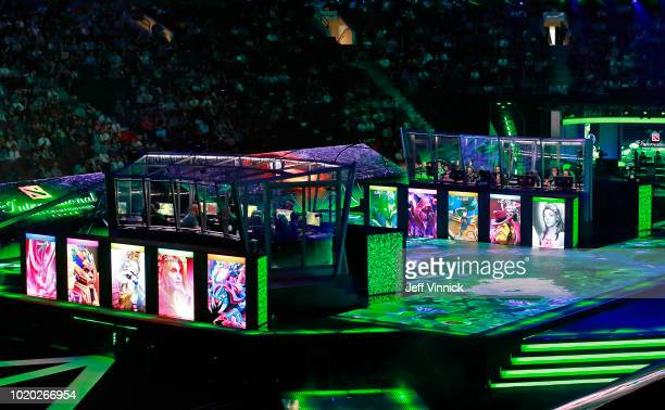 Virtuspro and PSGLGD sit in their booths as they compete in their match during the first day of the International 2018 Dota 2 Championships at Rogers...