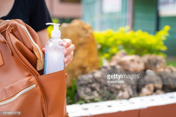 covid-19 virus anti-bacterial hand sanitizer gel - anti quarantine stock pictures, royalty-free photos & images