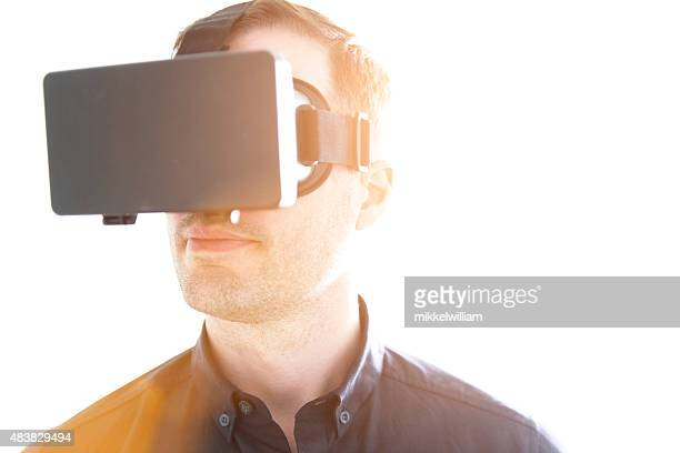 Virutal reality glasses worn by a man