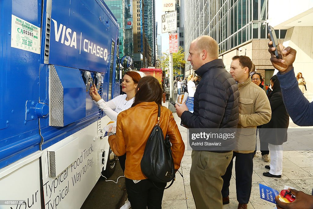 Visa and Chase celebrate the launch of Apple Pay with free doughnuts for all New Yorkers from Dough on October 20, 2014 in New York City.