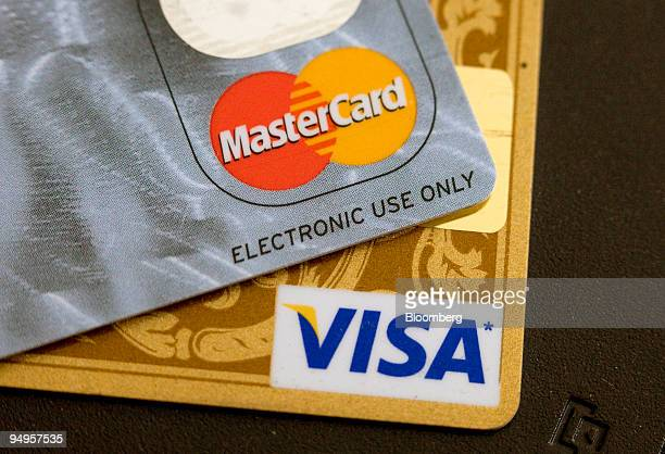 Visa and MasterCard credit cards are arranged for a photo in Toronto Ontario Canada on Thursday May 21 2009 Canada will introduce new disclosure and...