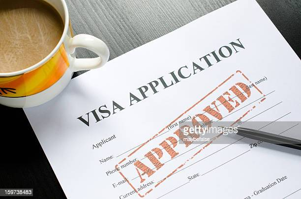 visa application - approved - passport stamp stock photos and pictures