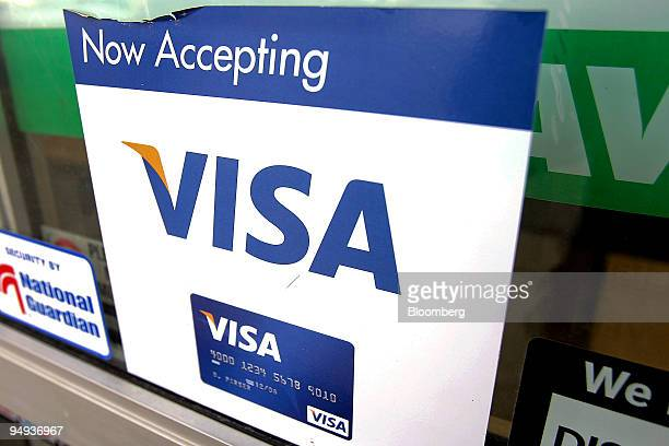 Visa credit card sign is displayed in a store window in Des Plaines Illinois US on Tuesday Feb 3 2008 Visa Inc the worlds largest electronic payments...