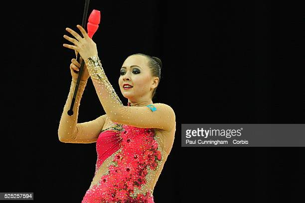 Visa Federation of International Gymnastics Anna Alyabyeva of Kazakhstan performs with the Clubs during the Final of the Women's Rhythmic Olympic...