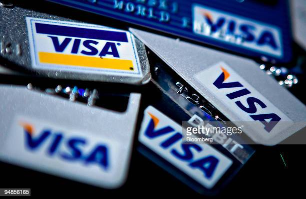 Visa Inc credit and debit cards are arranged for a photo in Washington DC US on Tuesday March 18 2008 Visa Inc the largest paymentcard network set a...