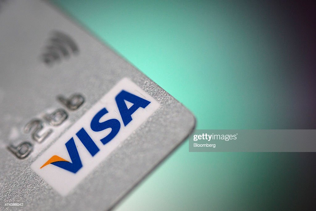 A Visa Inc. logo sits on a credit card in this arranged photograph, in London, U.K., on Friday, May 22, 2015. Credit and debit cards that can be used by tapping the reader are gaining users, and mobile apps are set to further boost the popularity of contactless paying. Photographer: Simon Dawson/Bloomberg via Getty Images