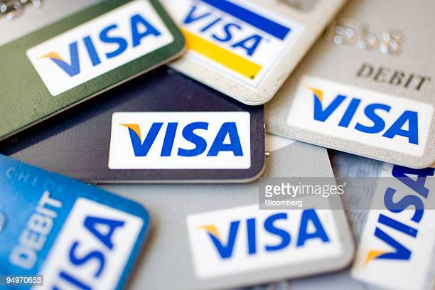 Visa logos appear on credit and debit cards arranged for a photograph in New York US on Thursday July 30 2009 Visa Inc the world's biggest electronic...