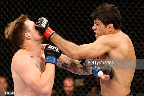 Viscardi Andrade punches Bristol Marunde in their welterweight bout during UFC 163 at HSBC Arena on August 3 2013 in Rio de Janeiro Brazil