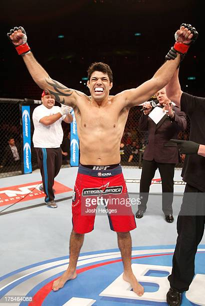 Viscardi Andrade reacts after his knockout victory over Bristol Marunde in their welterweight bout during UFC 163 at HSBC Arena on August 3 2013 in...