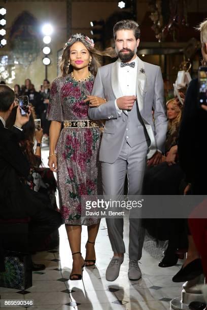 Viscontessa Emma Weymouth and Jack Guiness walk the runway at the Dolce Gabbana Italian Christmas at Harrods on November 2 2017 in London England