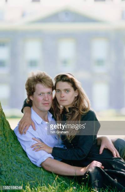 Viscount Althorp, Charles Spencer, and his fiancee, British model Victoria Lockwood, sit beneath a tree in the grounds of the Spencer family home,...