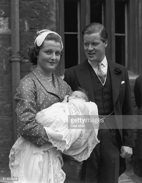 Viscount Althorp with his wife Hon Frances Roche with their baby daughter Sarah sister of Lady Diana Spencer after her christening at Westminster...