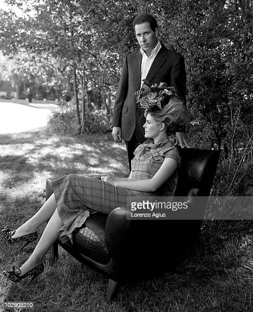 Viscount David Linley and his wife Countess Serena Linley pose for a portrait shoot in London