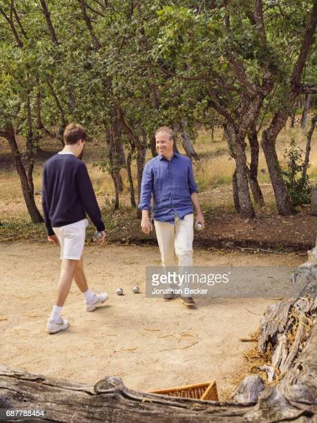 Viscount David Linley the second Earl of Snowdon and son Charles are photographed for Vanity Fair Magazine on July 13 2016 playing petanque at...
