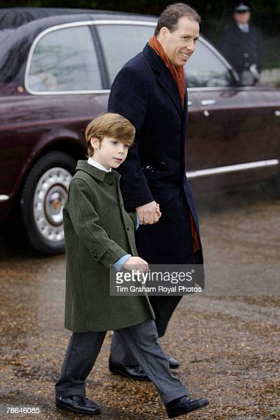 Viscount Linley with his son Charles wearing a traditional loden style coat joins other members of the Royal Family for Christmas Day service at...