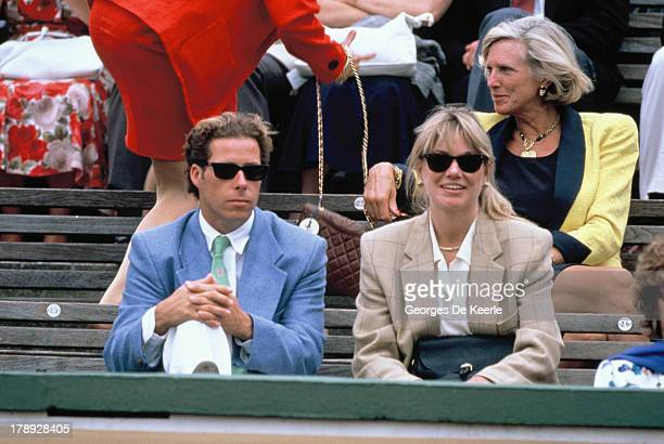 Viscount Linley with Kate Menzies attend the final match of the Stella Artois Championships between Ivan Lendl and Boris Becker at Queen's Club, on...