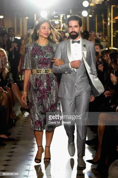 Viscountess Emma Weymouth and Jack Guinness walk the Dolce Gabbana Italian Christmas catwalk show at Harrods on November 2 2017 in London England